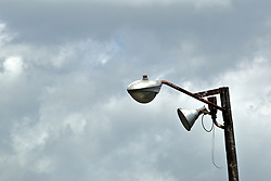 A cut electrical wire prevents a pair of street lamps mounted on a wooden pole from operating