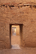 Filtered light fills the many room seen through the doorways in this stone ruin of Pueblo Bonito at the Chaco Canyon Cultural National Monument in northwest New Mexico