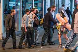 © Licensed to London News Pictures . 15/06/2014 . Manchester , UK . A group of men carry another man who cannot stand up by himself . People on a night out in Manchester City Centre overnight , following England's defeat to Italy in the World Cup . Photo credit : Joel Goodman/LNP