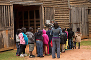 A guide gives students a tour of the President Jimmy Carter Boyhood Farm museum May 6, 2013 in Plains, Georgia.