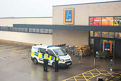 © Licensed to London News Pictures. 22/12/2017. Skipton UK. Picture shows police at the scene where a 30 year old woman has died after she was stabbed in an Aldi supermarket in Skipton. North Yorkshire Police have arrested a 44 year old man on suspicion of murder following the attack shortly before 3:30 pm on Thursday. Photo credit: Andrew McCaren/LNP