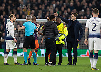 Football - 2018 / 2019 UEFA Champions League - Quarter Final , First Leg: Tottenham Hotspur vs. Manchester City<br /> <br /> Mauricio Pochettino, Manager of Tottenham FC, helps remove the pitch inavder at White Hart Lane Stadium.<br /> <br /> COLORSPORT/DANIEL BEARHAM
