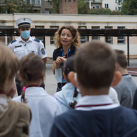 Police officers inform students about traffic safety after an opening ceremony on the first day of schol in Budapest, Hungary on Sept. 1, 2020. ATTILA VOLGYI