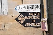 Signs: Chateau Fonplegade, Union de Producteurs. The town. Saint Emilion, Bordeaux, France