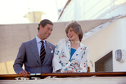 The laughing cavalier and his lady, the Prince and Princess of Wales, in a merry mood aboard the Royal Yacht Britannia as she sails away from Gibraltar today for the rest of their honeymoon.