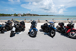 Bikes at the staging area before the finish of the Cross Country Chase motorcycle endurance run from Sault Sainte Marie, MI to Key West, FL. (for vintage bikes from 1930-1948). The staging area on a Key West pier just before the finish and near the end of the 110 mile Stage-10 ride from Miami to Key West, FL USA. Sunday, September 15, 2019. Photography ©2019 Michael Lichter.