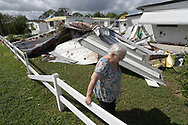 Cherie Monroe pauses after looking at the roof of her home in the aftermath of Hurricane Matthew in the Tanglewood subdivision in Port Orange, Florida, U.S. October 9, 2016.  REUTERS/Phelan Ebenhack