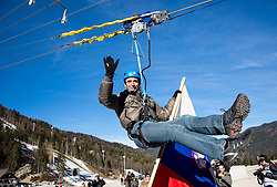 Franci Petek on zipline at official opening of the new Nordic centre Planica, on December 11, 2015 in Planica, Slovenia. Photo by Vid Ponikvar / Sportida
