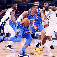 09 November 2017: Oklahoma City Thunder guard Russell Westbrook (0) drives past Denver Nuggets guard Emmanuel Mudiay (0) and Denver Nuggets forward Paul Millsap (4) during the Denver Nuggets 102-94 victory over the Oklahoma City Thunder, at the Pepsi Center, Denver, Colorado, USA.