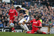 Joe Ledley of Cardiff City is tackled by Wes Morgan of Nottingham Forest. Coca cola championship, Cardiff City v Nottingham Forest at Ninian Park in Cardiff on Sat 31st Jan 2009..pic by Andrew Orchard, Andrew Orchard sports photography,