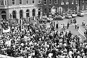Women's Peace March In Dublin  (K50)..1976..28.08.1976..08.28.1976..28th August 1976..As part of the Peace Movement, set up by Ms Betty Williams and Ms Mairead Maguire in Northern Ireland, a march was organised for Dublin. Thousands of women took part in the march from St Stephen's Green, Dublin to the seat of government in Leinster House on Merrion Square, Dublin, to protest the continuing violence within the country..Image taken as the peace and anti capital punishment groups pass each other on the corner of St Stephen's Green