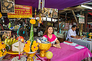 04 JANUARY 2013 - BANGKOK, THAILAND:  A fortune teller at Wat Mahabut in eastern Bangkok. The temple was built in 1762 and predates the founding of the city of Bangkok. Just a few minutes from downtown Bangkok, the neighborhoods around Wat Mahabut are interlaced with canals and still resemble the Bangkok of 60 years ago. Wat Mahabut is a large temple off Sukhumvit Soi 77. The temple is the site of many shrines to Thai ghosts. Many fortune tellers also work on the temple's grounds.   PHOTO BY JACK KURTZ