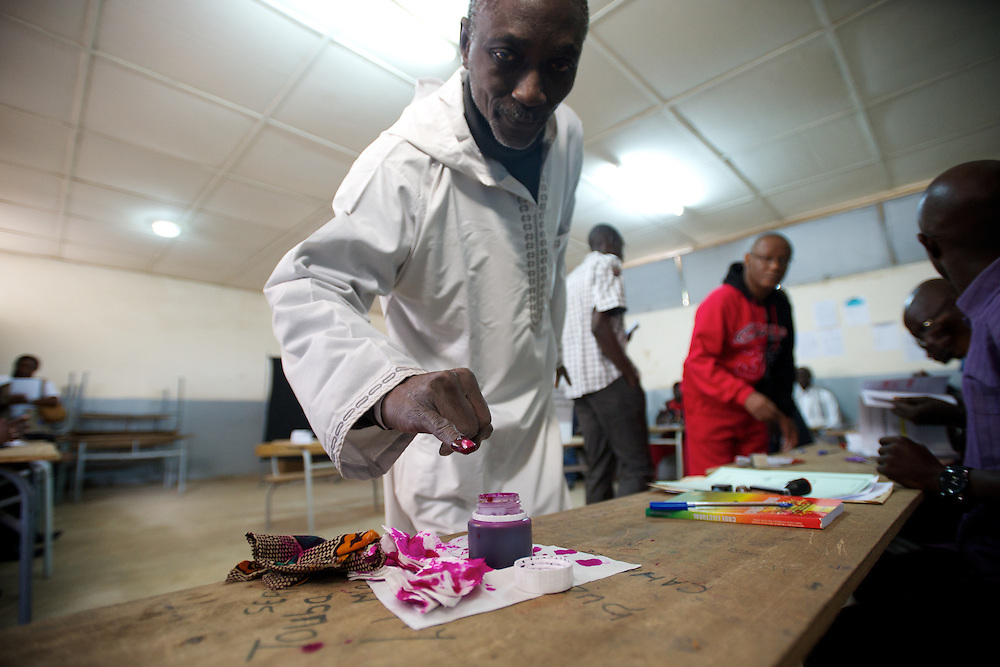 February 26, 2012 - Dakar, Senegal: A senegalese man marks his finger after casting his vote on the senegalese presidential elections at a polling station in Franco-Arab School in Point E area of Dakar. Hundreds arriving for voting in the early hours. (Paulo Nunes dos Santos/Polaris)