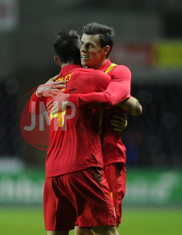 Gareth Bale (Tottenham Hotspur) of Wales  celebrates scoring the opening goal of the game for Wales with Joe Ledley (Celtic) of Wales - Photo mandatory by-line: Joe Meredith/JMP - Tel: Mobile: 07966 386802 06/02/2013 - SPORT - FOOTBALL - Liberty Stadium - Swansea  -  Wales V Austria - International Friendly