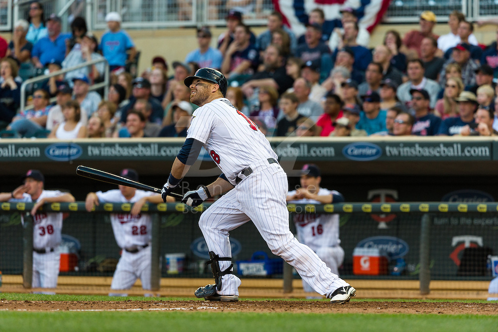 Ryan Doumit #18 of the Minnesota Twins watches his grand slam home run land in the right field seats during a game against the Detroit Tigers on September 29, 2012 at Target Field in Minneapolis, Minnesota.  The Tigers defeated the Twins 6 to 4.  Photo: Ben Krause