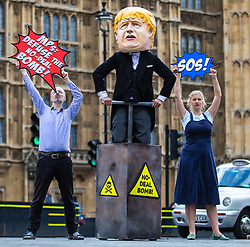 """© Licensed to London News Pictures. FILE PICTURE: 03/09/2019. London, UK. ANTONIA STAATS (right) joins other campaigners from Avaaz in holding a photo-call outside Parliament with a man dressed as Prime Minister Boris Johnson pushing the plunger on a """"No-Deal Bomb"""". Antonia Staats has reportedly been in a relationship with Government scientist Neil Ferguson, which involved the breaking of lockdown rules. Photo credit: Rob Pinney/LNP"""