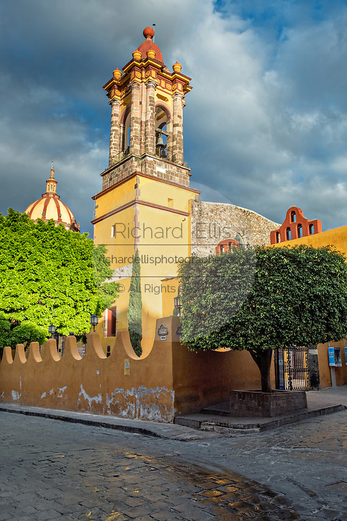 Dome and steeple of the Church of the Immaculate Conception also called the Nuns at sunrise in the historic district of San Miguel de Allende, Mexico.
