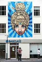 © Licensed to London News Pictures.  30/07/2017; Bristol, UK. Upfest 2017. Work by Bristol artists 3DOM and Voyder on Barclays Bank at Upfest, Europe's largest street art festival held annually in Bedminster, Bristol. The festival officially runs from 29 - 31 July with over 350 artists live painting in 37 locations. Picture credit : Simon Chapman/LNP