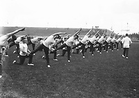 H532<br /> Tailteann Games. Gymnastics display.One of the movements durrng the gymnastc display Iby the Civic Guards, under Inspector McCreancr, at Oroke Park on Friday evening. 1924. (Part of the Independent Newspapers Ireland/NLI Collection)