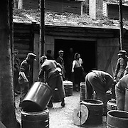 A Jewish woman inmate in Gunskirchen Lager camp, liberated by the 71st Infantry Division, directs German P.O.Ws on cleaning up kitchen facilities. May 6, 1945