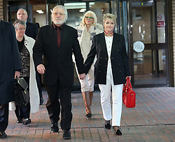 Dave Lee Travis and his wife Marianne Griffin leaving Southwark Crown Court in London after being told there will be a re- trial on two sexual assault charges,  Monday, 24th February 2014. Picture by Stephen Lock / i-Images