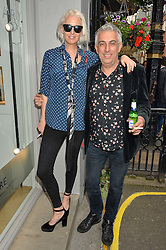 The HON.SOPHIA HESKETH and RIFAT OZBEK at a private view of photographs by Jolyon Fenwick 'The Zero Hours Panoramas' 100 Years On: Views From The Parapet of The Somme held at Sladmore Contemporary, 32 Bruton Place, London on 30th June 2016.