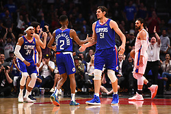 October 19, 2018 - Los Angeles, CA, U.S. - LOS ANGELES, CA - OCTOBER 19: Los Angeles Clippers Guard Shai Gilgeous-Alexander (2) gives Los Angeles Clippers Center Boban Marjanovic (51) a high five after a basket during a NBA game between the Oklahoma City Thunder and the Los Angeles Clippers on October 19, 2018 at STAPLES Center in Los Angeles, CA. (Credit Image: © Brian Rothmuller/Icon SMI via ZUMA Press)