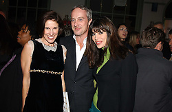 Left to right, NORI STARCK, ANTON BILTON and his wife LISA B at a party to celebrate the publication of Style by interior designer Kelly Hoppen held at 50 Cheyne Walk, London on 10th November 2004.<br />