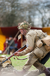 Reeactor portraying a Technician/4th Grade (T4 or Technical Sergeant)  paratrooper from the US 82nd Airborne (All American).carrying a Springfield 1903 .30-06 caliber Rifle.21 April  2013.Image © Paul David Drabble
