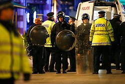 """© Licensed to London News Pictures. 24/02/2016. London, UK. Police in riot gear on scene of a """"hostage situation"""" at Bella Italia restaurant in Leicester Square, London where a man claiming to be in possession of a knife is holding a woman against her will. Metropolitan Police reported the incident is not terrorist-related. Photo credit: Tolga Akmen/LNP"""