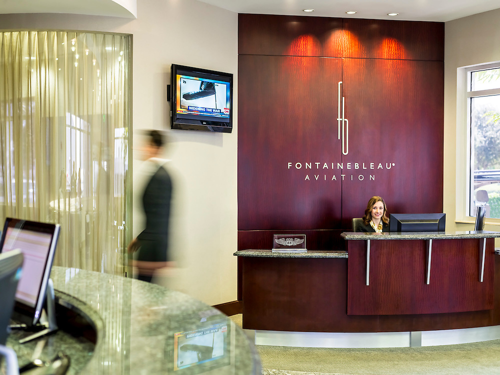 Fontainebleau Aviation concierge desk in their lobby at Opa-locka Executive Airport, near Miami.  <br /> <br /> Created by aviation photographer John Slemp of Aerographs Aviation Photography. Clients include Goodyear Aviation Tires, Phillips 66 Aviation Fuels, Smithsonian Air & Space magazine, and The Lindbergh Foundation.  Specialising in high end commercial aviation photography and the supply of aviation stock photography for advertising, corporate, and editorial use.
