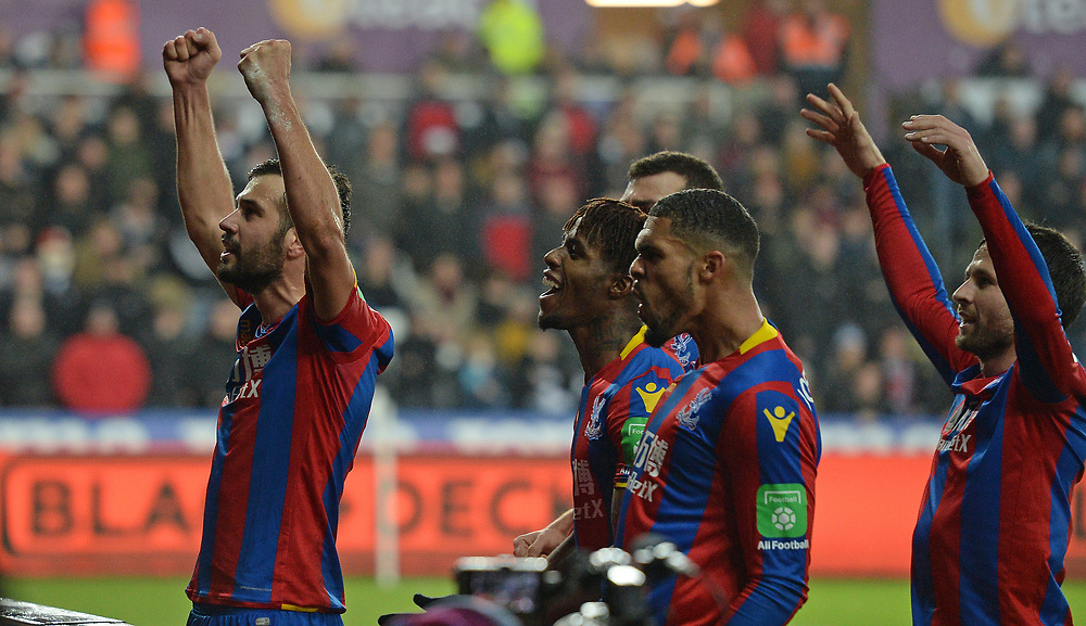 Crystal Palace's Luka Milivojevic celebrates scoring his side's first goal with team-mate's Wilfried Zaha and Ruben Loftus-Cheek<br /> <br /> Photographer Ian Cook/CameraSport<br /> <br /> The Premier League - Swansea City v Crystal Palace - Saturday 23rd December 2017 - Liberty Stadium - Swansea<br /> <br /> World Copyright © 2017 CameraSport. All rights reserved. 43 Linden Ave. Countesthorpe. Leicester. England. LE8 5PG - Tel: +44 (0) 116 277 4147 - admin@camerasport.com - www.camerasport.com