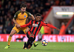 Brighton & Hove Albion's Davy Propper (left) and AFC Bournemouth's Jordon Ibe battle for the ball during the Premier League match at the Vitality Stadium, Bournemouth.