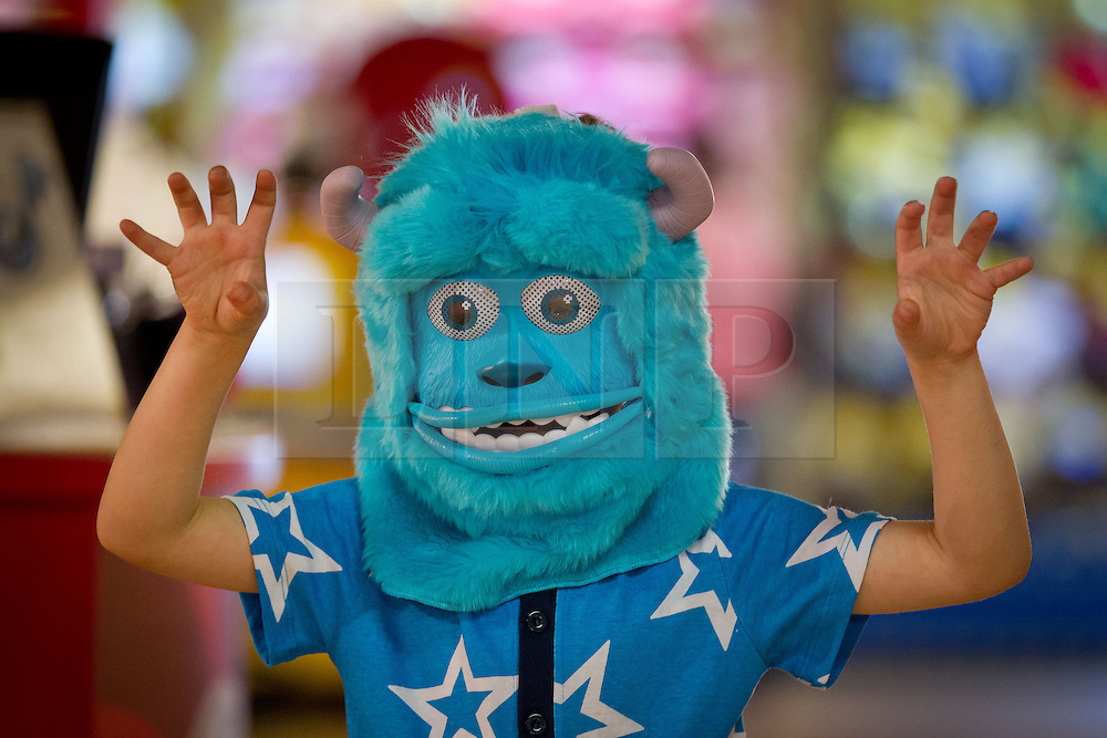 © Licensed to London News Pictures. 27/06/2013. London, UK. Jonah, 6, is seen wearing a 'Sulley Monster Mask' (Hamleys price GB£40) at the Christmas in June press event at Hamleys toy shop in London today (27/06/2013).  Held in retailers world famous Regents Street store, the event showcases the predicted top toys for Christmas 2013. Photo credit: Matt Cetti-Roberts/LNP