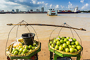 """17 JUNE 2013 - YANGON, MYANMAR:   A fruit vendor's stand in front of a Yangon bound ferry crossing the Yangon River. The ferry to Dala opposite Yangon on the Yangon River is the main form of transportation across the river. Every day the ferry moves tens of thousands of people across the river. Many working class Burmese live in Dala and work in Yangon. The ferry is also popular with tourists who want to experience the """"real"""" Myanmar. The rides takes about 15 minutes. Burmese pay about the equivalent of .06¢ US for a ticket.  Foreigners pay about the equivalent of about $4.50 US for the same ticket.  PHOTO BY JACK KURTZ"""