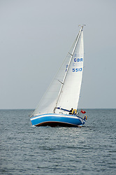 A small Yacht sailing off the coast close to  Whitby harbor.September 2010 .Images © Paul David Drabble