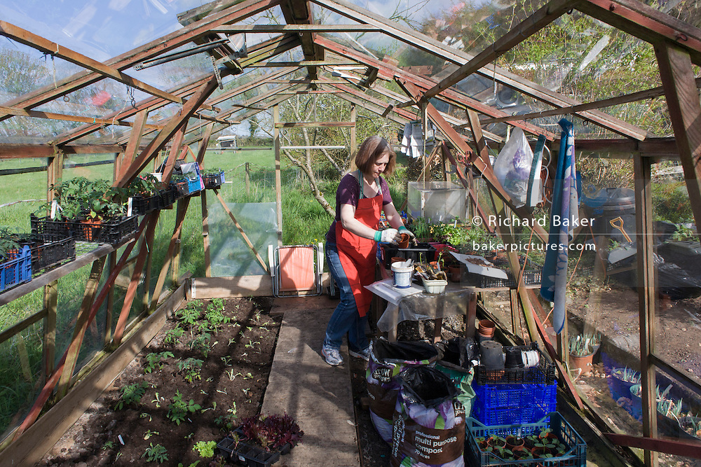 A family in their greenhouse potting shed on a north Somerset farmstead.