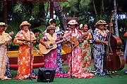 Ukulele players in muumuu dresses, Kapiolani Park, Waikiki, Honolulu, Oahu, Hawaii