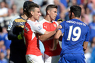 Gabriel of Arsenal fights with Diego Costa of Chelsea with Laurent Koscielny of Arsenal and Goalkeeper Petr Cech of Arsenal trying to break it up. Barclays Premier League match, Chelsea v Arsenal at Stamford Bridge in London on Saturday 19th September 2015.<br /> pic by John Patrick Fletcher, Andrew Orchard sports photography.