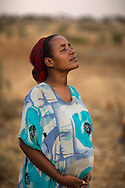 """Mekya Ganemo, 24, is 8 months pregnant with her first child. <br /> <br /> """"I must become a mother because I am a woman,"""" says Mekya Ganemo, 24. """"I am happy to meet this child. When we have a baby we celebrate by preparing special foods like porridge and performing a coffee ceremony. The whole family celebrates together. If the baby is a boy the celebration is grander because he will grow up and stay with the family and bring a wife into the family.""""<br /> <br /> She's been receiving fortified Corn Soy Blend (CSB) from Catholic Relief Services through generous funding from the American people and USAID since she was three months along. The porridge only takes 10 minutes to prepare and has all the nutrients a mother needs to ensure a healthy baby. A health extension worker regularly checks in on Mekya to make sure that she is using the CSB correctly and helping to prepare her for childbirth and caring for a newborn. Expectant and lactating mothers and children under 5 who are showing signs of undernourishment in the community receive the CSB."""