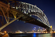 Sydney Opera House, Centre and Harbour Bridge after sunset.