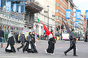 Young men and women of Shia Muslim believers who were allowed to be physically present at the Imambaras with precautions like wearing masks and maintaining social distancing are observing the narration of the tragedy of Karbala in Marble Arch, central London on Sunday, Aug 30, 2020. People above sixty years of age have been asked to stay home and observe Muharram through live-streamed on various social media platforms like YouTube and Facebook. (VXP Photo/ Vudi Xhymshiti)