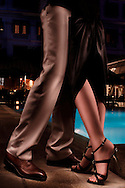 A man and a woman dance together by the side of a pool in the evening, Hanoi, Vietnam, Southeast Asia
