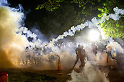 Police deploy tear gas canisters against protestors who threw them back during clashes in front of the White House following the death of George Floyd at the hands of Minneapolis Police in Washington, D.C. on May 31, 2020.