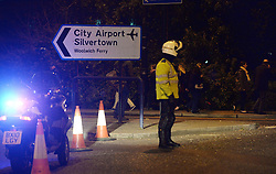 Police outside London City Airport which has been closed as dozens of passengers have been treated for breathing difficulties after a suspected chemical incident at the airport.