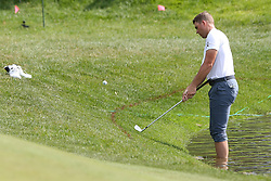 June 21, 2018 - Cromwell, Connecticut, United States - CROMWELL, CT-JUNE 21: Luke List hits a shot out of the water on to the 15th green during the first round of the Travelers Championship on June 21, 2018 at TPC River Highlands in Cromwell, Connecticut. (Credit Image: © Debby Wong via ZUMA Wire)