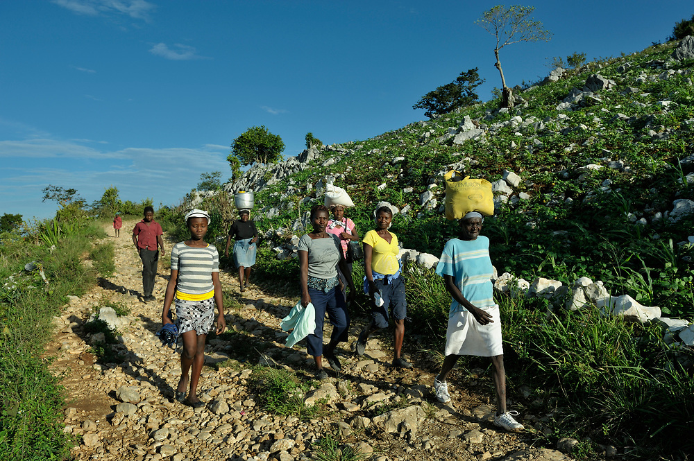People walking to a weekly market in Despagne, an isolated village in southern Haiti where the Lutheran World Federation has been working with residents to improve their quality of life.