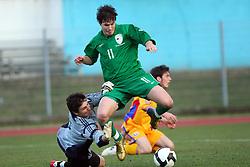 Etien Velikonja (11)  of Slovenia vs Goalkeeper of Romania Silvu Lung during Friendly match between U-21 National teams of Slovenia and Romania, on February 11, 2009, in Nova Gorica, Slovenia. (Photo by Vid Ponikvar / Sportida)