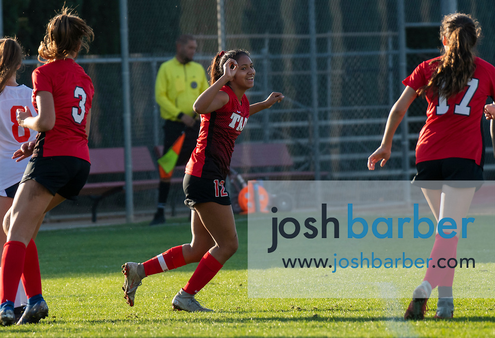 Troy's Aaliyah Tu'ua (12) celebrates after scoring a first-half goal during a nonleague game against Cypress at Troy High School on Thursday, December 12, 2019 in Fullerton, Calif. (Photo by Josh Barber for The Orange County Register/SCNG)