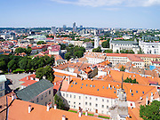 High-angle view across Vilnius from the Vilnius University belltower, in Senamiestyje/Old Town, Vilnius, Lithuania, withe Vilnius Clocktower and Vilnius Cathedral in the midground.